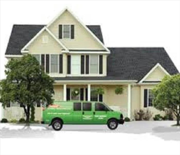 SERVPRO van parked in front of a home