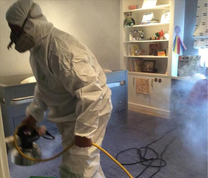 SERVPRO worker disinfecting